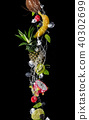 Pieces of fruit in water splash, isolated 40302699