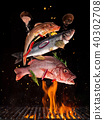 Flying raw whole fish from grill grid 40302708