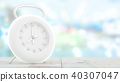 modern clock on wood table and blurred bokeh 40307047