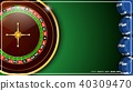 Casino roulette wheel with casino chips on green c 40309470