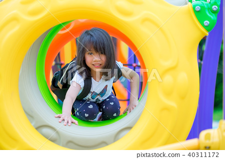asia kid having fun to play on children's climbing 40311172