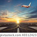 Commercial airplane flying above runway in sunset  40312423