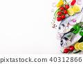 Uncooked fish on dark vintage background. Free 40312866