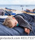 infant boy sleeping on the beach 40317337
