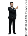 Full Body Young Asian Businessman Pointing Something Isolated  40320993
