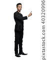 Full Body Young Asian Businessman Pointing Something Isolated 40320996
