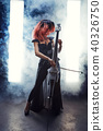 The cellist girl performs on stage. 40326750