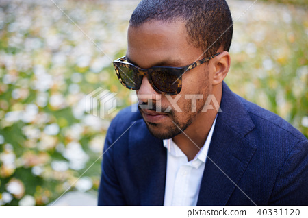 Closeup Portrait of Happy confident young African-American businessman in formal wear and sunglasses 40331120
