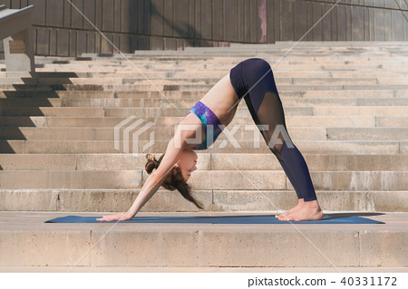 Fitness woman doing yoga urban practice outdoors. Healthy young girl practising yoga on seaside 40331172