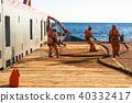 AHTS vessel doing static tow tanker lifting. Ocean tug job 40332417