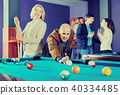 Group of happy charming friends playing billiards 40334485