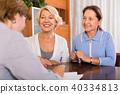 Senior ladies with agent 40334813