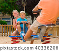 Cheerful children are teetering on the swing 40336206