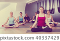 Females in yoga position Padmasana at gym 40337429