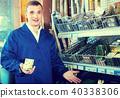 workman holding metal furniture 40338306