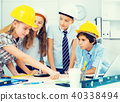 Boys and girls architects with plan 40338494