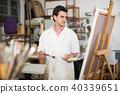 Artist painting on canvas 40339651