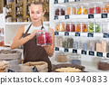 Girl seller is demonstraiting Flower of Hibiscus 40340833