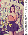 Woman keeping professional racket and balls 40341245