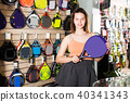 Woman holding professional racket for tennis 40341343