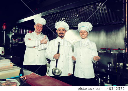 Professional cooks welcoming to their workplace 40342572