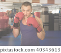 Portrait of young male who is boxing 40343613