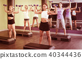 Girls exercising with dumbbells 40344436