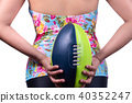 women in swimming suit and rugby football 40352247