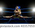 Thai boxer on boxing ring do the splits 40357050