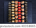 Restaurant sushi menu. Top view on stone table with delicious fr 40358665