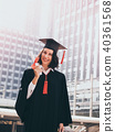 Young woman with graduation cap and gown 40361568
