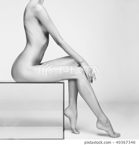 Nude woman with perfect body on gray background 40367346