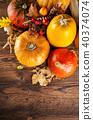 Autumn pumpkins on wooden planks 40374074