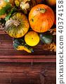 Autumn pumpkins on wooden planks 40374158