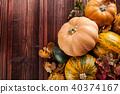 Autumn pumpkins on wooden planks 40374167