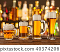 Glasses of light beer with bar on background 40374206