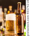 Jug of beer with bottle served on bar counter 40374218