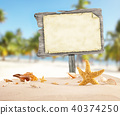 Summer beach with blank wooden poster 40374250
