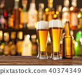 Glasses of light beer with bar on background 40374349