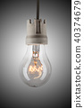 Light bulb hanging on wire 40374679