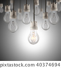 Light bulbs in row with single one shinning 40374694