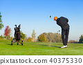 Man playing golf on green course 40375330