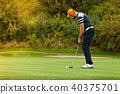 Golf player with club 40375701