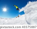 Jumping snowboarder at jump 40375887