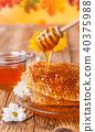 Fresh honey with dipper 40375988