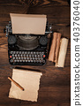 Old typewriter on wooden table 40376040