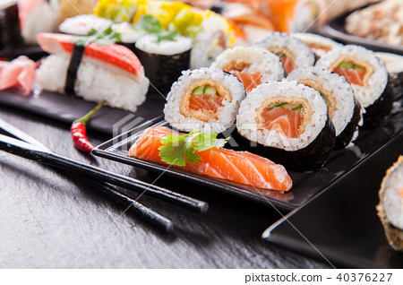 Delicious sushi pieces served on black stone 40376227