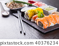 Delicious sushi pieces served on black stone 40376234