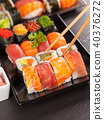 sushi pieces with chopsticks 40376272