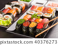 sushi pieces with chopsticks 40376273